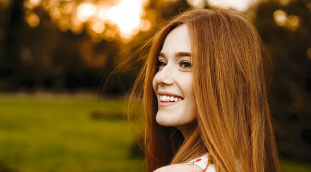 A happy woman after a hair transplant