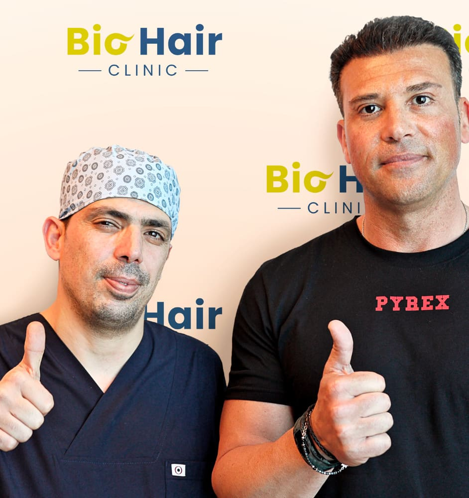 Dr Ibrahim with a patient after the DHI Hair Transplant