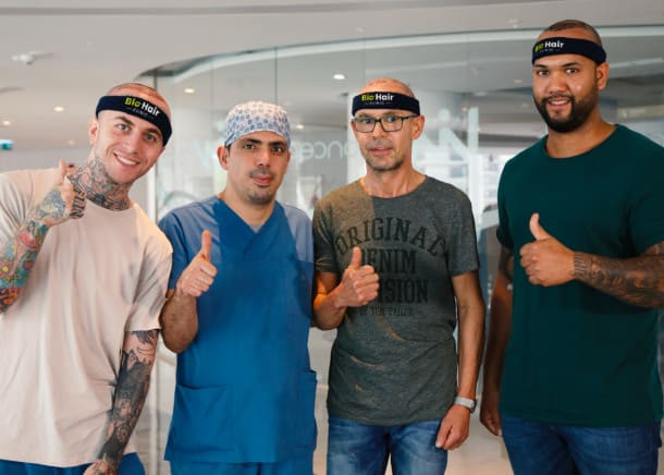 Dr. Ibrahim with three patients after the procedure at the hair transplant clinic