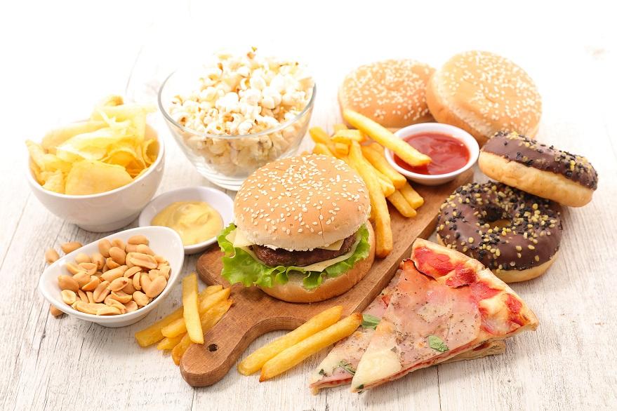 Fettige Lebensmittel als falsche Ernährung gegen Haarausfall